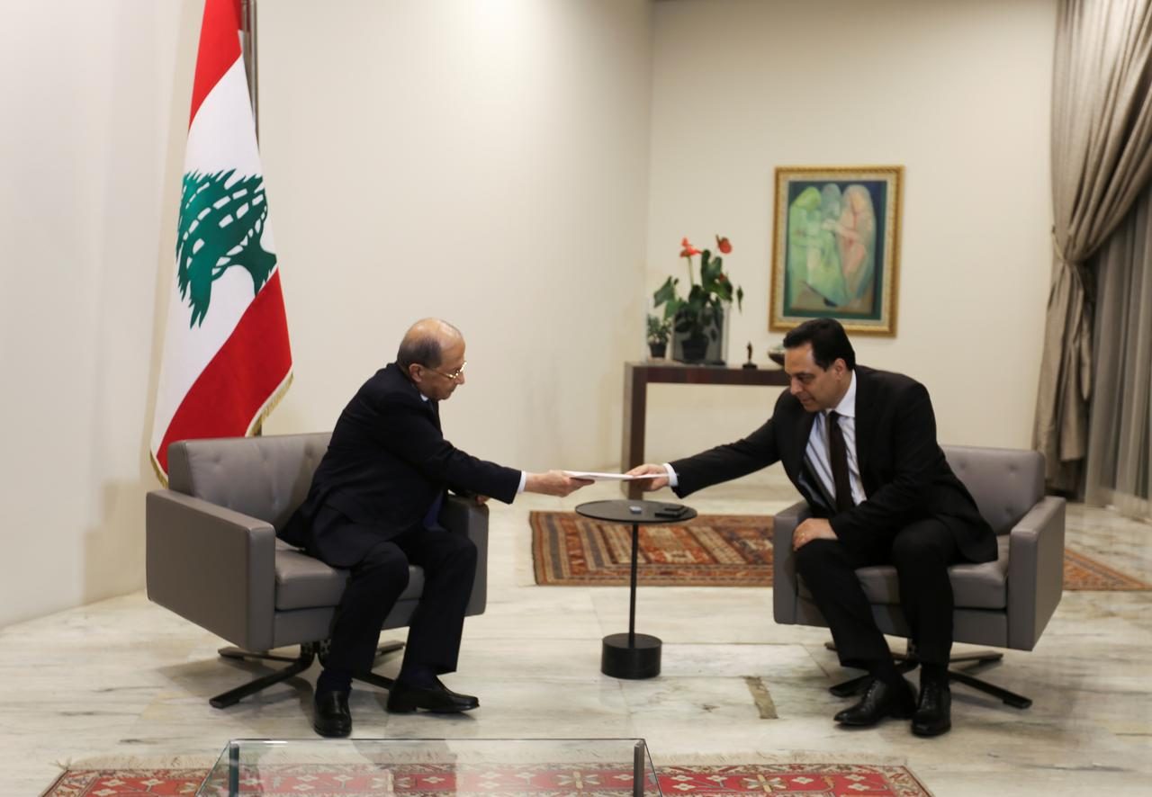 Lebanon's Prime Minister Hassan Diab submits his resignation to Lebanon's President Michel Aoun at the presidential palace in Baabda, Lebanon August 10, 2020. REUTERS/Aziz Taher
