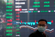 Photo of Asian shares mostly lower, China gains on GDP rebound